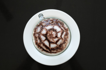 Top view coffe mocha on black tabel background