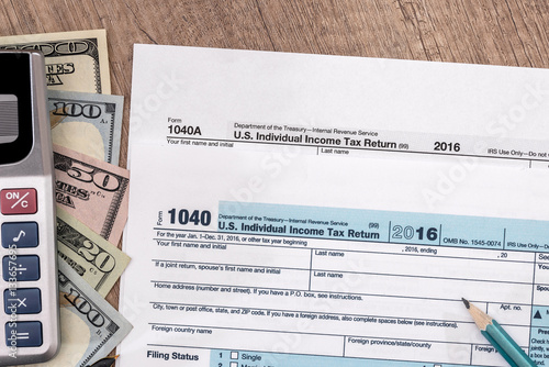 Tax time u s 1040 tax return for 2017 year with pen for 1040 line 28 tax table