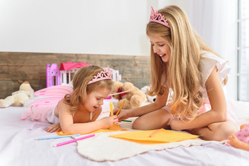 Cheerful kids creating a picture