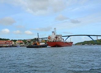 ship traffic near the Queen Juliana Bridge in the   St Anna Bay in Willemstad, Curacao