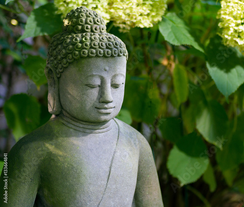 buddha im garten stock photo and royalty free images on. Black Bedroom Furniture Sets. Home Design Ideas