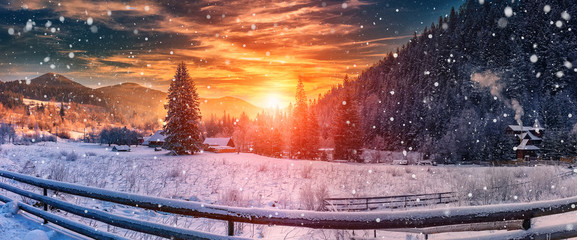 majestic sunset at winter. wonderful wintry view in mountain village. colorful sky over the hills. picturesque amazing scene. christmas concept. instagram toning. creative image.
