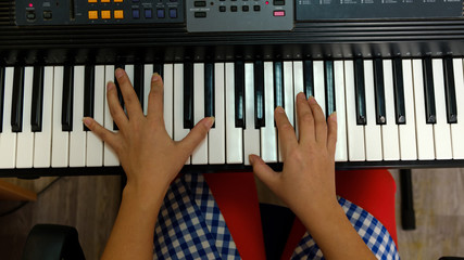 the hands of a musician, plays keyboards.