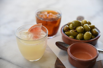Iced drinks and green olives
