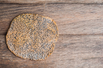 The Vietnamese Sesame Rice Cracker is called Banh Da and is made of tapioca flour, rice flour, salt, and sprinkled with black sesame seeds