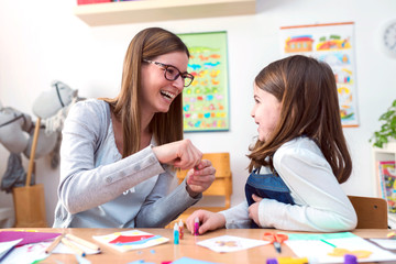 Mother with creative kid having fun time together