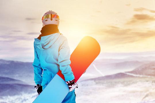 Snowboarder woman girl sunrise mountain top
