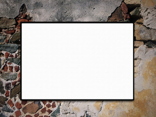 Blank Canvas on a Stone Wall
