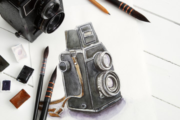 Watercolor sketch of retro camera, vintage camera and watercolor paints.