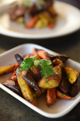 Colourful roasted root vegetables in serving dish
