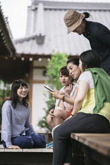Group of japanese tourists using a tablet