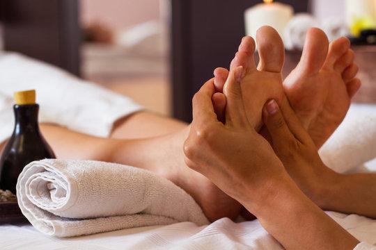 Massage of human foot in spa salon - Soft focus