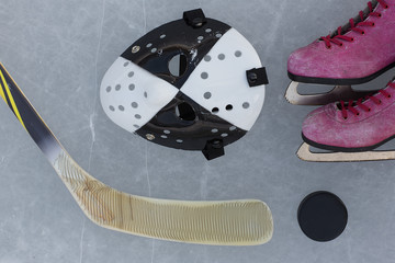 hockey stick, goalie mask, skating and puck on the ice