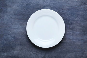 Empty plate on grey wooden table