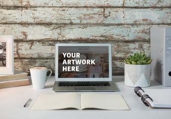 Laptop on Desk with Weathered Background Mockup