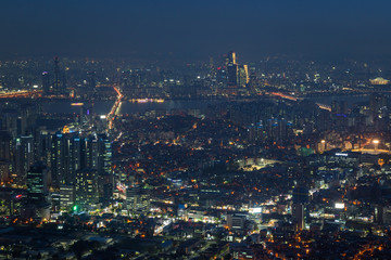 View of downtown in Seoul, South Korea, from above at night.