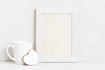 Vertical empty white wooden frame