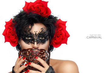 Gorgeous dark haired beauty in masquerade mask