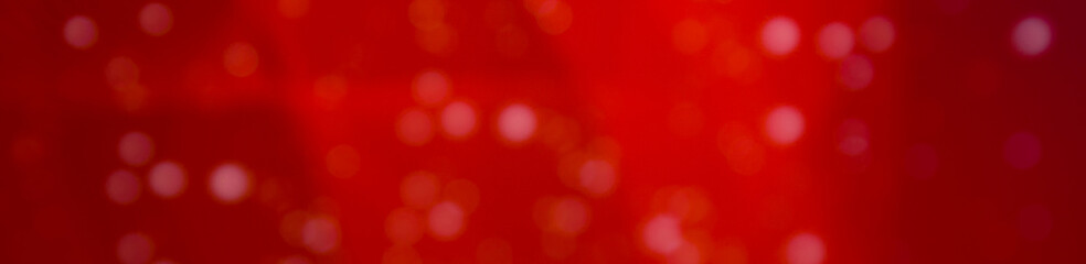 Glitter sparkling abstract red bokeh defocused background, border design panoramic banner