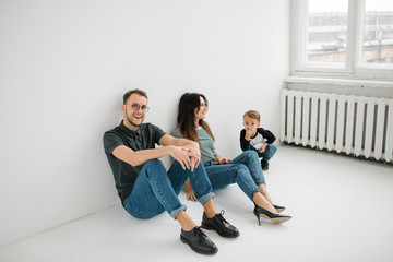 Hipster father, mother holding baby boy over white isolated back