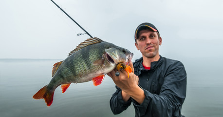 Fisherman with perch trophy