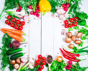 Beautiful frame of different vegetables and spices on the white boards with free space for you text. Studio photography of healthy organic eating