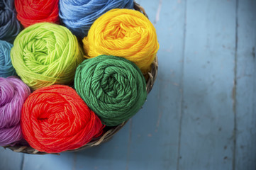 Blurry background colorful knitting in wooden basket