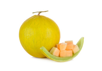 whole and portion cut fresh yellow melon with stem on white back