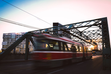 A bus crossing a bridge at sunset in Toronto, Canada.