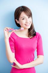beauty woman brush her teeth