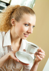 woman drinking coffee, at home