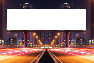 Double exposure of white blank billboard on blur light trails, street, city and urban in the night - can advertisement for display or montage product or business.