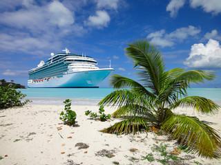 Cruise ship anchored close to a tropical beach in the Caribbean Sea.