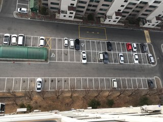 elevated view of parked cars in parking area