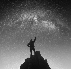 Champion against night landscape. Black and white