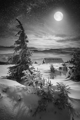 Moon rise at Christmas winter night. Black and white