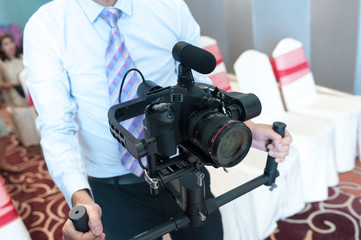videographer with gimball video slr,videographer using steadycam