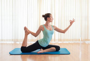 Woman practicing yoga indoors.