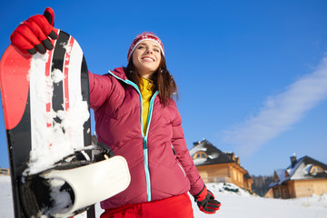 beautiful woman with a snowboard. Sport concept