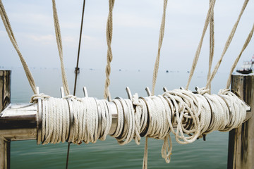 Rope knot on boat sea background as a strong nautical marine lin