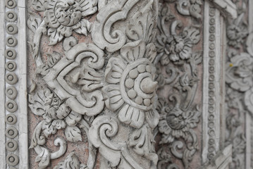 Plaster carvings of Thai style on the temple wall