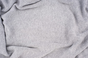 close up grey knitted pullover background.