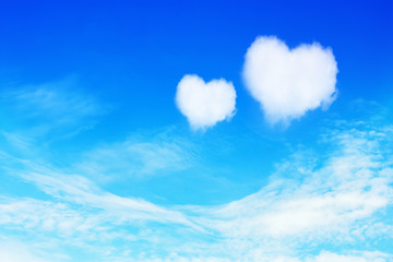 two heart shaped clouds on blue sky for valentine background