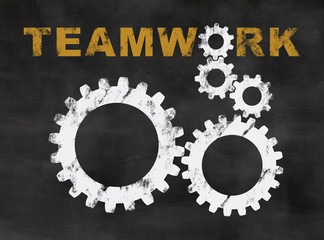 gearwheels on a blackboard, concept for teamwork and collaboration