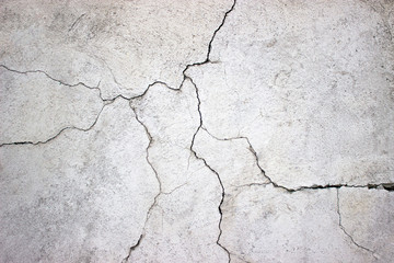 cracked concrete wall covered with gray cement texture as backgr