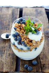 Healthy Breakfast of Granola blueberries and yogurt