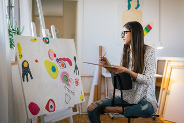 Bringing her creativity to life.woman painting in her art studio
