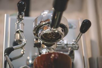 Delicious fresh morning coffee pouring through the bottomless portafilter