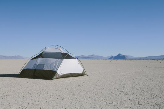 Camping tent on vast playa, Black Rock Desert, Nevada