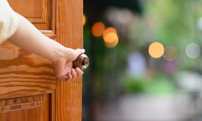 Women hand open door knob or opening the door. Fototapete